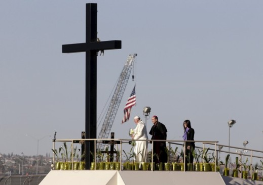 Pope Francis stands next to a wooden cross at the border between Mexico and the U.S. in Ciudad Juarez,